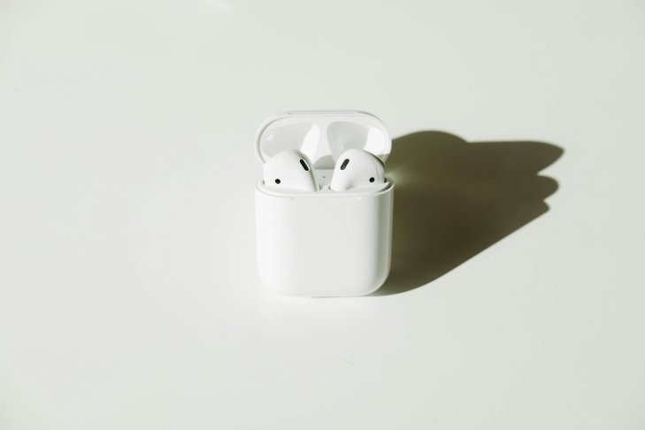 Chic plain Flatlay consisting Airpods.
