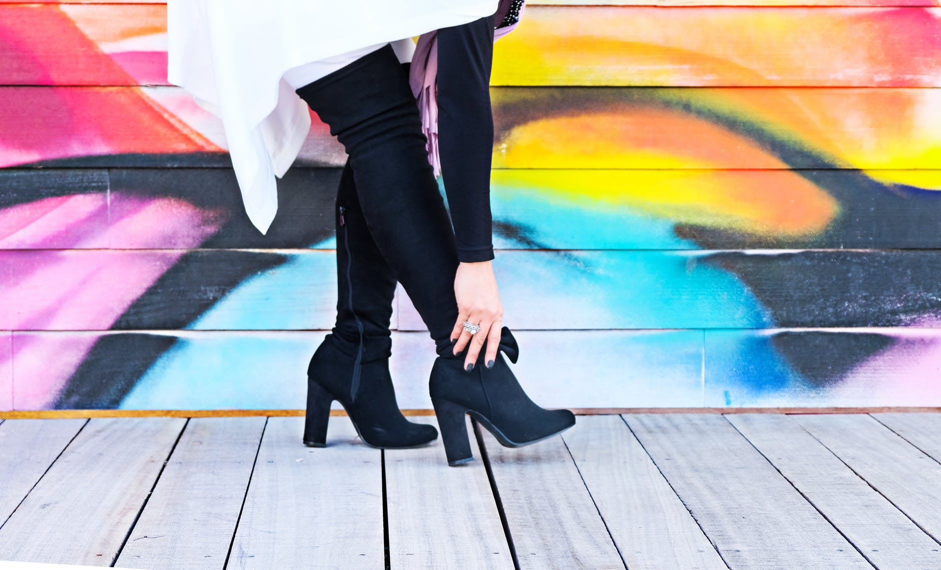 Black knee high length ankle boots for fall fashion.