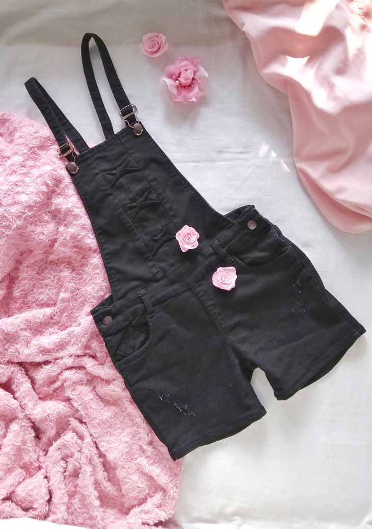 A black denim overalls in an outfit Flatlay.