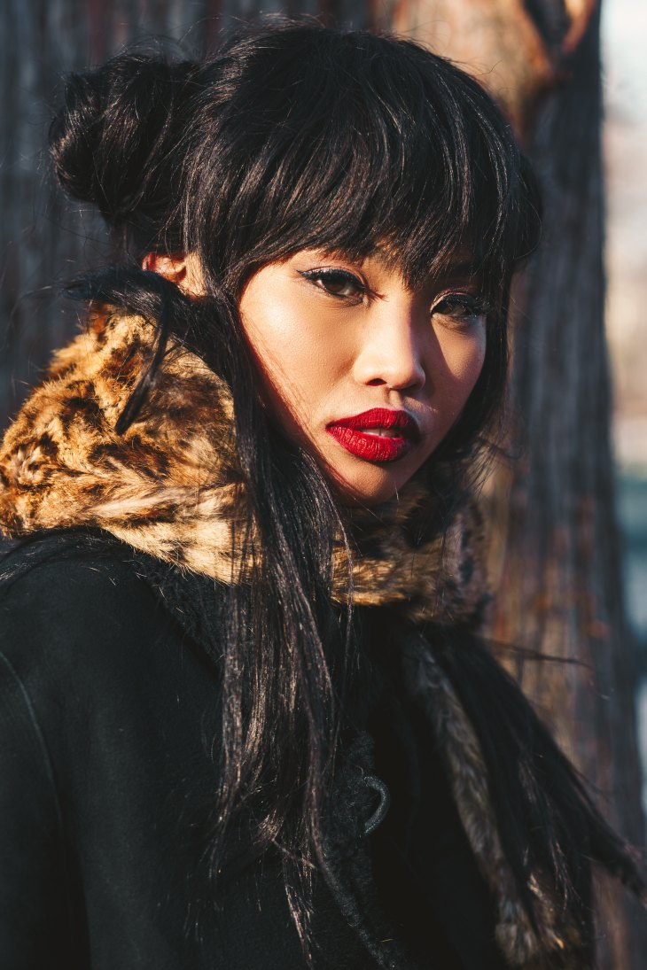 Leopard print scarf adorned by a beautiful asian.