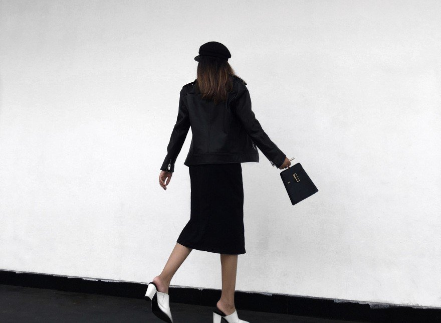 A blogger wearing polished and chic work wear.