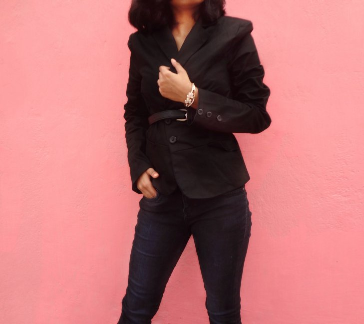 Styling business chic; belted blazer with black denim.