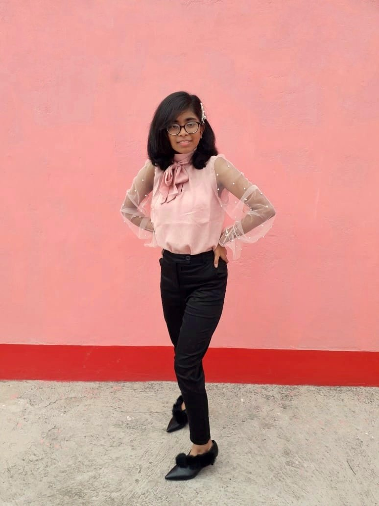 Corporate chic outfit combination consisting of a millennial pink blouse and straight-leg pants with fur embellished heels.