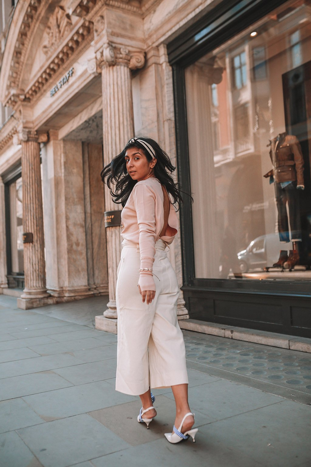 Light pink open back top paired with wide legged pants