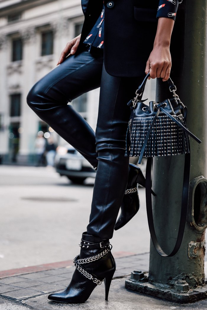 Black patent leather pants and ankle boots